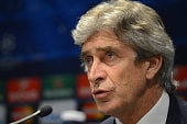 Manchester City manager Manuel Pellegrini in discussion during a Press Conference.
