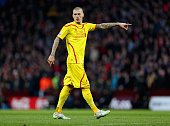 Liverpool defender Martin Skrtel gestures whilst in action for his side in the English Premier League