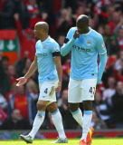 Yaya Toure and Vincent Kompany look dejected whilst in action for English Premier League side Manchester City