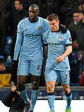 James Milner celebrates with Yaya Toure after Manchester City score a goal