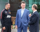 Manchester United manager Louis Van Gaal in conversation with his assistant Ryan Giggs and chairman Ed Woodward