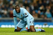 Manchester City midfielder Yaya Toure falls to the ground during a Premier League match