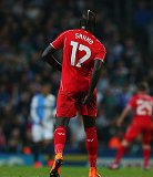 Liverpool defender Mamadou Sakho holds on to his hamstring