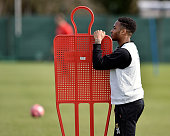 Raheem Sterling looks on during a training session with Liverpool