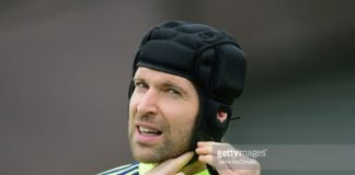 Keeper Petr Cech at Chelsea doing up his protective cap