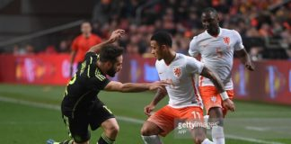 Winger Memphis Depay attempts to skip past his opponent whilst representing his home country of Holland
