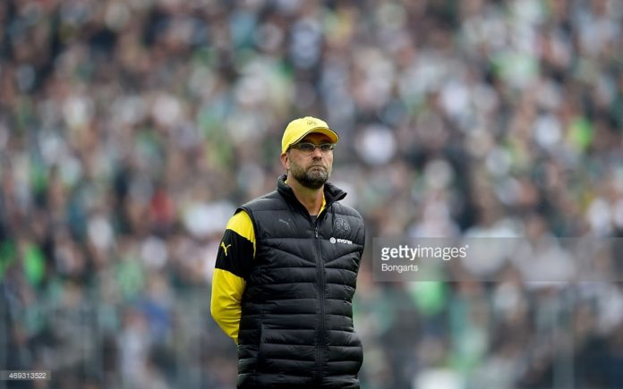 Borussia Dortmund manager Jurgen Klopp watches on from the sidelines.