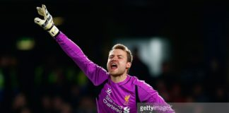 Keeper Simon Mignolet of Liverpool shouts at his defence