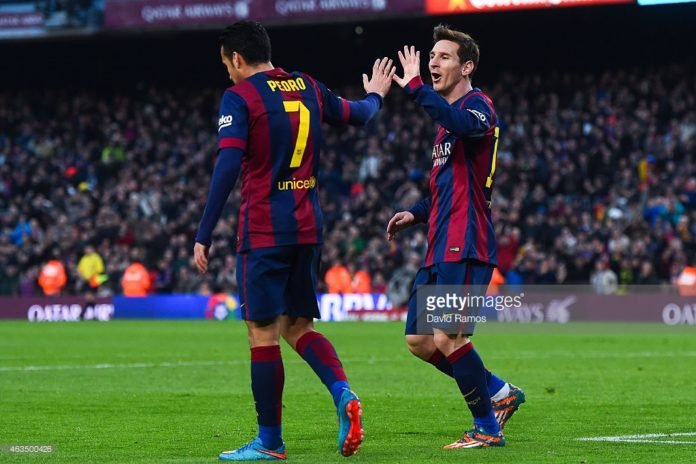 Pedro salutes Messi whilst at Barcelona