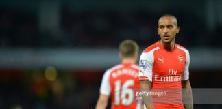 Striker Theo Walcott watches on whilst in action for Arsenal