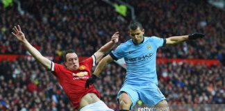 Phil Jones of Manchester United tackles Aguero
