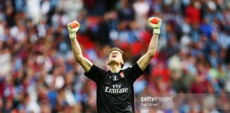 Wojciech Szczesny punches the air in celebration for Arsenal