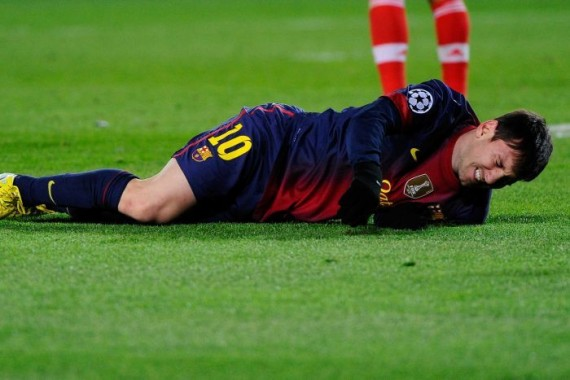 Down and out: Lionel Messi faces two months out with a knee injury