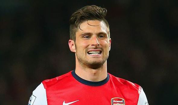 Testing times: Giroud struggled to impose himself against Spurs