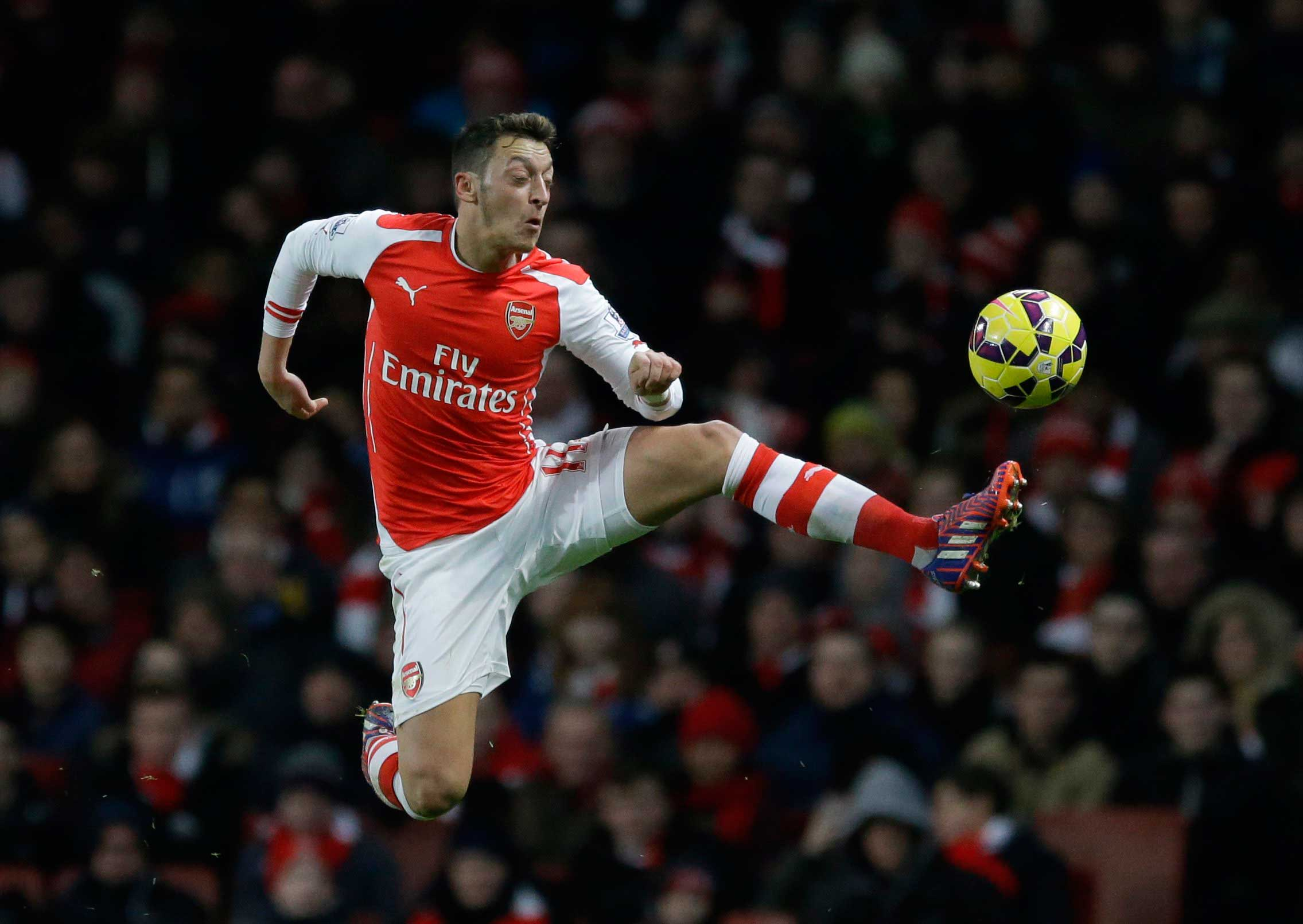 Gunner stay: Arsenal are keen to tie Ozil down to new deal