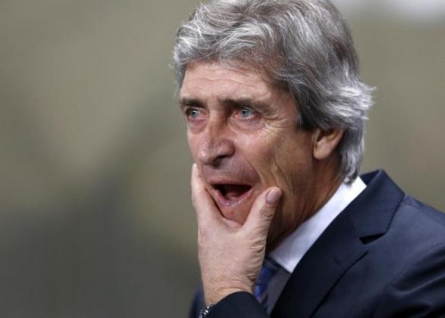 Gunned down: Pellegrini's team have slipped four points behind Arsenal
