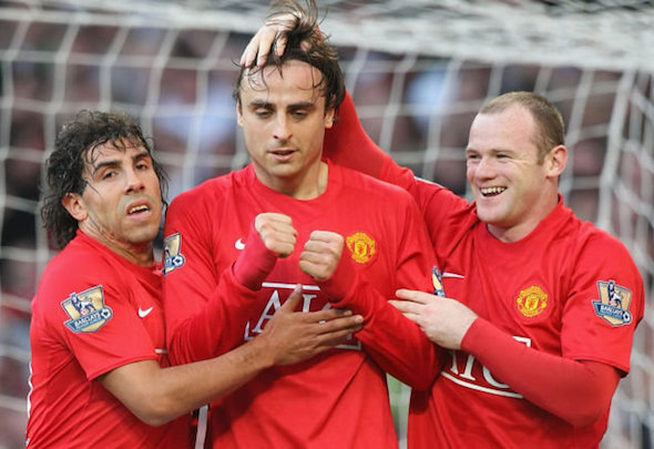 Frozen out: Carlos Tevez and Wayne Rooney do not make Berbatov's dream team