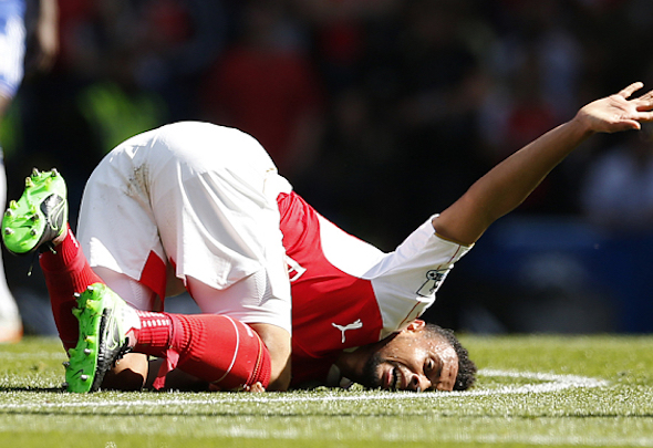 Shattering blow: Coquelin could be out for six months with knee ligament damage