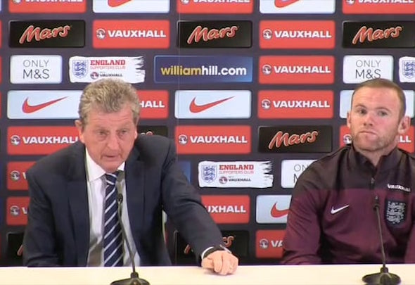 United front: Roy Hodson and Wayne Rooney said their sympathies are with the French squad