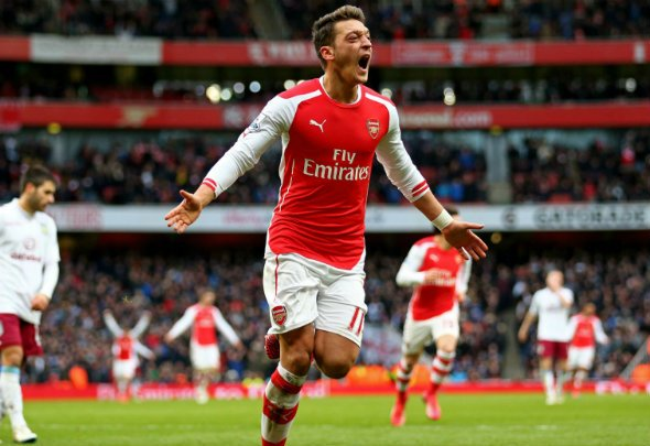 Red hot: Mesut Ozil has been in outstanding form this season