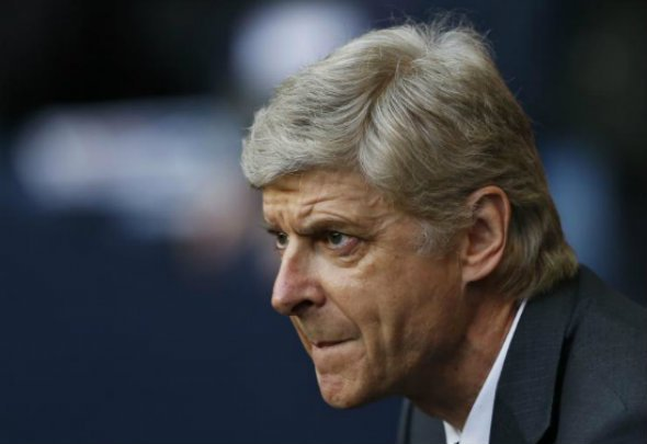 Close ally: Wenger has leaped to the defence of Van Gaal after Mourinho link