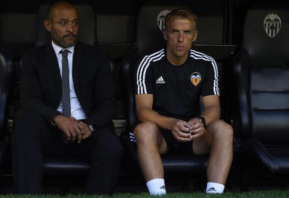 Helping hand: Phil Neville has been on the Valencia staff since the summer