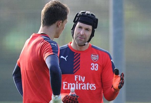 Matt Macey gets some tips from Petr Cech after signing new Arsenal contract