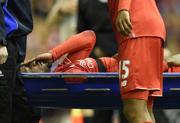 Divock Origi was stretchered off with suspected ankle ligament damage in Merseyside derby