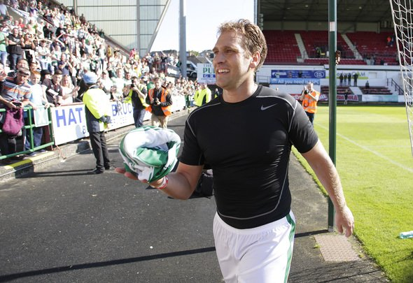 Football - Dunfermline Athletic v Celtic - Jock Stein 30th Anniversary Charity Match - East End Park - 6/9/15 Celtic Legends' Stiliyan Petrov prepares to give his shirt to a supporter Action Images via Reuters / Graham Stuart Livepic EDITORIAL USE ONLY.