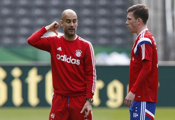 Bayern Munich's coach Pep Guardiola (L) chats with Pierre-Emile Hojbjerg during a training session before the German soccer cup (DFB Pokal) final against Borussia Dortmund in Berlin May 16, 2014. Dortmund and Bayern Munich play the German soccer cup (DFB Pokal) final match on Saturday at the Olympic Stadium in Berlin.  REUTERS/Tobias Schwarz (GERMANY  - Tags: SPORT SOCCER)    Picture Supplied by Action Images