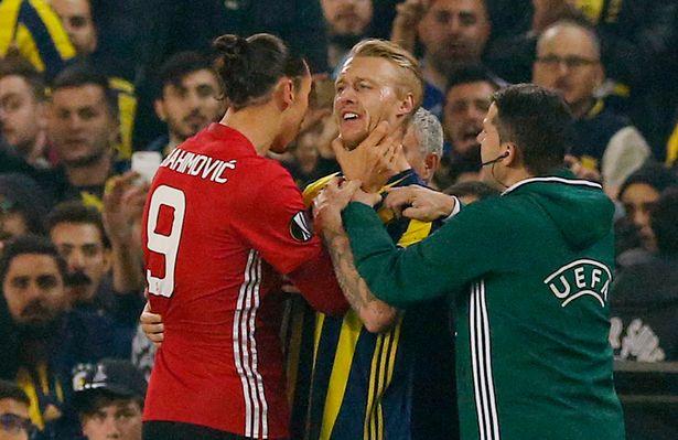 Manchester United's Zlatan Ibrahimovic clashes with Fenerbahces Simon Kjaer
