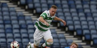 Mark Hill breaks out of a tackle for his Scottish club Celtic