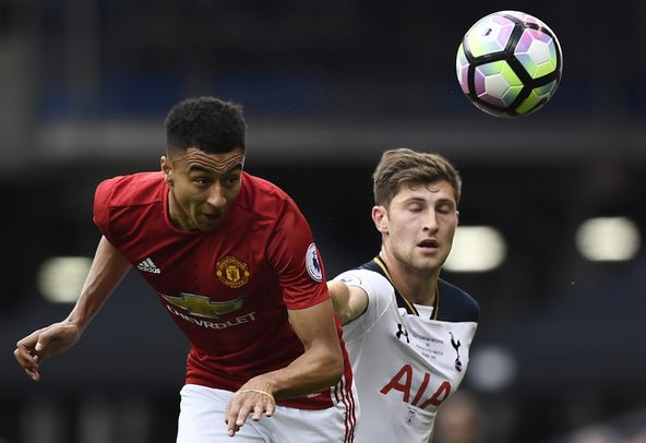 Ben Davies of Tottenham battles with Jesse Lingard of Manchester United