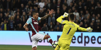 Hugo Lloris of Tottenham looks to save an effort from Manuel Lanzini of West Ham