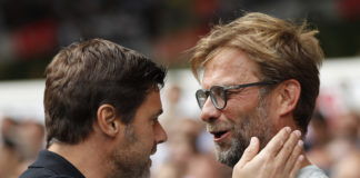 Mauricio Pochettino of Tottenham embraces Jurgen Klopp of Liverpool