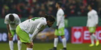 Ricardo Rodriguez of Vfl Wolfsburg looks dejected