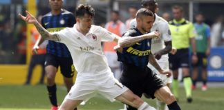 Alessio Romagnoli of AC Milan makes a tackle