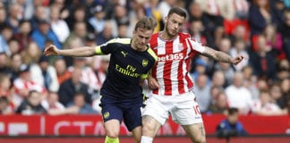 Rob Holding of Arsenal battles for the ball with Marko Arnautovic of Stoke City