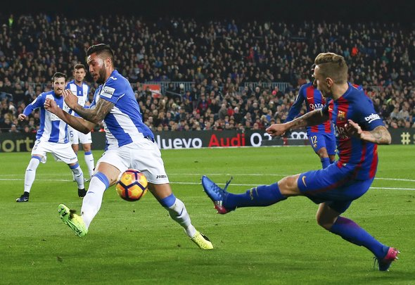 Lucas Digne crosses for his Spanish club Barcelona
