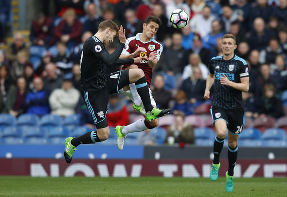 Burnley Ashley Westwood battles in mid-air with West Brom Sam Field