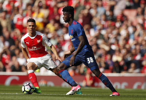 Kieran Gibbs of Arsenal looks to make a tackle