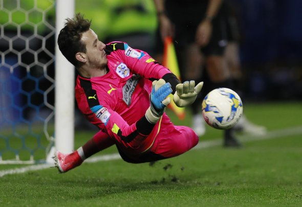 Danny Ward of Liverpool makes a penalty save for Huddersfield Town during a loan spell