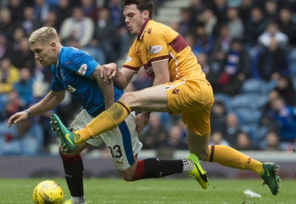 Ben Heneghan of Motherwell attempts to make a tackle