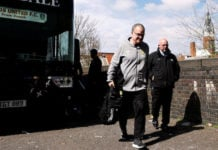 Leeds United manager Marcelo Bielsa gets off the team bus