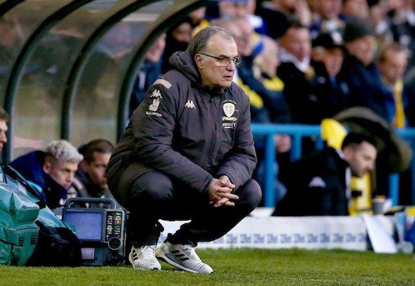 Leeds United manager Marcelo Bielsa hunches over