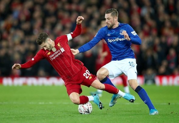 Everton playmaker Gylfi Sigurdsson struggles to outfox Liverpool star Adam Lallana