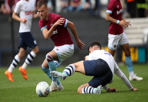 Preston North end defender Josh Earl tackles West Ham attacker Andriy Yarmolenko
