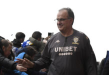 Leeds United manager Marcelo Bielsa waves at fans