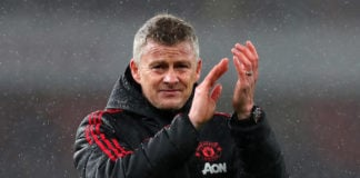 Manchester United manager Ole Gunnar Solskjaer claps in the rain