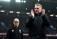 Leeds United manager Marcelo Bielsa looks at Aston Villa boss Dean Smith